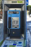 Payphone for city and long-distance calls Blanes, Spain. Spain, Blanes - 09/20/2012: Booth with payphone for city and long-distance calls royalty free stock photo