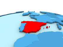 Spain on blue globe. Spain in red on simple blue political globe. 3D illustration Royalty Free Stock Photography