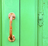 Spain   brass knocker  abstract door wood in the Royalty Free Stock Photo