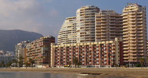 Spain calpe walking beach 4k hotels view stock footage