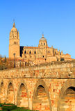 Spain, Castilla y Leon, Salamanca. Historical centre. Spain, Castilla y Leon, Salamanca. The cathedral and Roman bridge over the Tormes River in the late stock photos