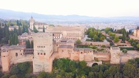 Spain castle Alhambra. Palace and fortress complex located in Granada, Andalusia. aerial Video footage from drone. Pink stock footage