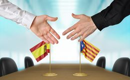 Spain and Catalonia diplomats shaking hands to agree deal, part 3D rendering. Two men reaching for a handshake in front of flags from Spain and Catalonia at a Royalty Free Stock Photo