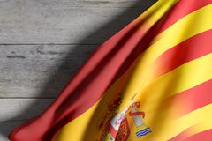 Spain and Catalonia flags. 3d rendering of a mixed of a Spain and Catalonia flag on a wooden surface Royalty Free Stock Photography