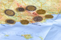 Spain Catalonia Political Crisis. Spainish Euro coins are seen over map of Catalonia region in Spain Stock Image