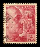 Portrait of General Franco with Coat of Arms. SPAIN - CIRCA 1940: a stamp printed in Spain shows portrait of General Francisco Franco, ruled over Spain as a royalty free stock images