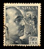 Portrait of General Franco with Coat of Arms. SPAIN - CIRCA 1940: a stamp printed in Spain shows portrait of General Francisco Franco, ruled over Spain as a stock photos