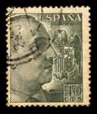 Portrait of General Franco with Coat of Arms. SPAIN - CIRCA 1939: a stamp printed in Spain shows portrait of General Francisco Franco, ruled over Spain as a stock image