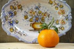 Spain concept, fresh mandarin oranges fruit with green leaves. Fresh mandarin oranges fruit with green leaves on wooden background stock photography