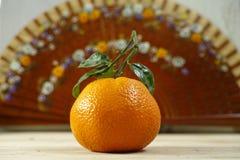 Spain concept, fresh mandarin oranges fruit with green leaves. Fresh mandarin oranges fruit with green leaves on wooden background stock images
