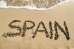 Spain - concept text on beach Stock Photos