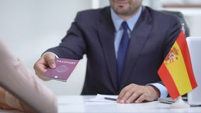 Spain consular officer giving passport to immigrant, work visa, citizenship. Stock footage stock video footage