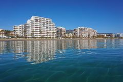 Spain Costa Brava apartment buildings along beach Royalty Free Stock Photos