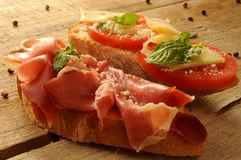 Spain culinary tapas ham iberico and tomatoes in olive oil Stock Photos