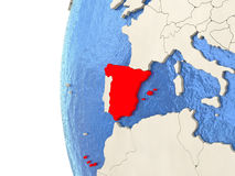 Spain on 3D globe. Map of Spain on globe with watery blue oceans and landmass with visible country borders. 3D illustration Royalty Free Stock Images