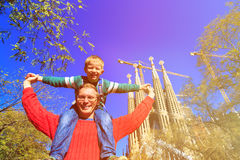 Spain family travel - happy father and son in front of Sagrada Familia, Barcelona Stock Photos