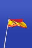 Spain flag. In a blue sky Stock Photos