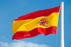 Spain flag. Flag of spain in the air on the blue sky background stock images