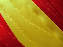 SPAIN flag or banner. Made with red and yellow ribbons royalty free stock photo