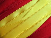 SPAIN flag or banner. Made with red and yellow ribbons royalty free stock images