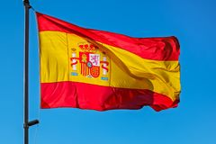 Spain flag on blue sky. Close view royalty free stock images
