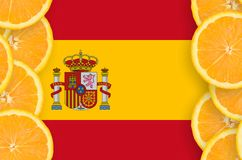 Spain flag in citrus fruit slices vertical frame. Spain flag in vertical frame of orange citrus fruit slices. Concept of growing as well as import and export of stock illustration