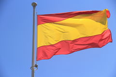 Spain flag without coat of arms to blue sky Royalty Free Stock Photography
