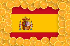 Spain flag in fresh citrus fruit slices frame. Spain flag in frame of orange citrus fruit slices. Concept of growing as well as import and export of citrus royalty free stock image