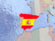 Spain with flag on globe Stock Image