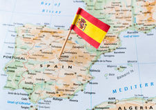 Spain flag on map. Spain paper flag pin on a map royalty free stock image