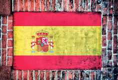 Spain flag. On the old bricks wall stock image