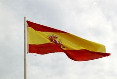 Spain Flag On A Blue Sky With Clouds Background Stock Photos