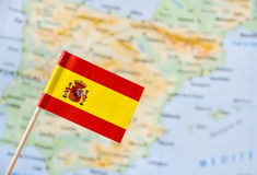 Spain flag. Spain paper flag pin blurry map background (series image Stock Image