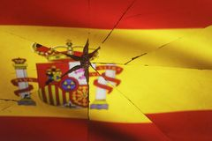Spain flag is reflected in broken mirror. And royalty free stock photo