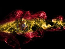 Spain flag smoke. Isolated on a black background stock photo