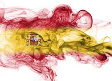Spain flag smoke. Isolated on a white background stock images