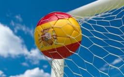 Spain flag and soccer ball in goal net. Spain flag and soccer ball, football in goal net stock photography