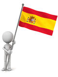 Spain flag. Spanish flag held up by a little man against white background, flag waving and hoisted in light wind Royalty Free Stock Image