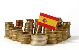 Spain flag with stack of money coins stock images