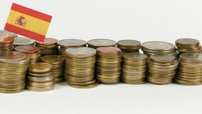 Spain flag with stack of money coins. Spain flag waving with stack of money coins stock footage