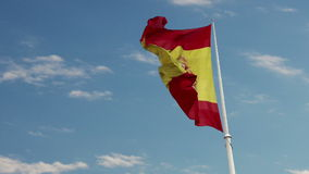 Spain Flag Waving in Blue Cloudscape Sky stock video