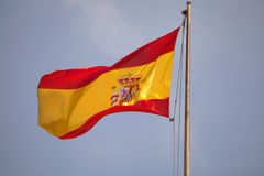 Spain flag waving in blue sky. Stock Photo