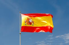 Spain flag waving on a blue sky. Spanish symbol Stock Photography