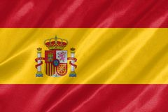 Spain Flag. With waving on satin texture royalty free stock image