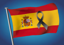 Spain flag waving on the sky with a black ribbon for victims Stock Photos