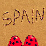 Spain. Flamenco shoes and the word spain written in the sand of a beach Stock Photography