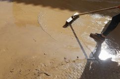 Villagers cleaning after floodings in San Llorenc in the island Mallorca vertical royalty free stock photos