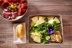 Spain food tapas ham sausage and cheese salad Stock Photos