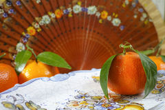 Spain fresh mandarin oranges fruit with green leaves. Fresh mandarin oranges fruit with green leaves on wooden background royalty free stock photography