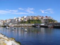 Spain Galicia Malpica Costa Da Morte Fishing Port. Spain Galicia Malpica Fishing Port with city buildings on rocks atlantic ocean costa da morte stock photo